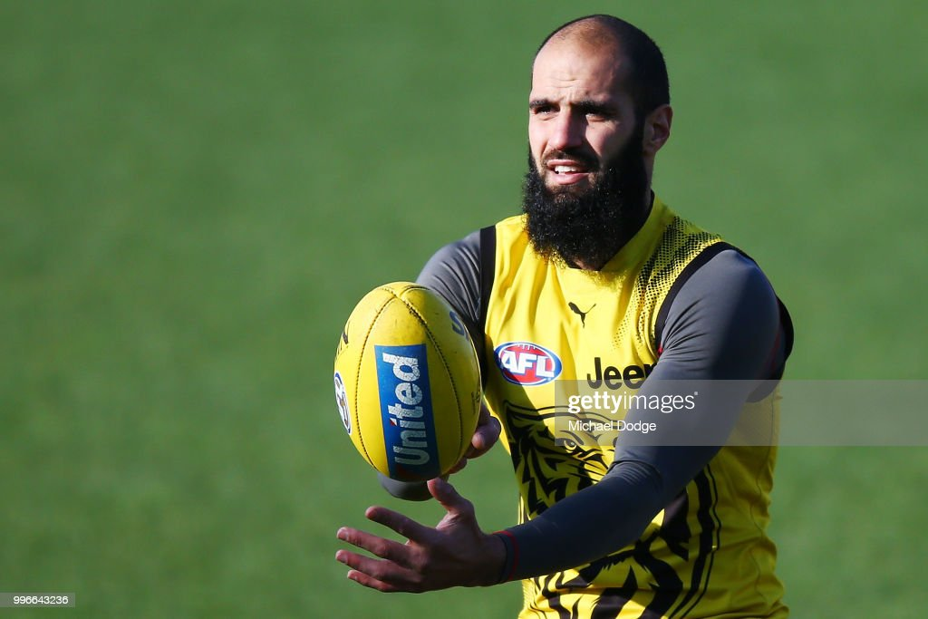 Bachar Houli of the Tigers, tipped by coach Damien Hardwick to return, handballs during a Richmond Tigers AFL training session at Punt Road Oval on July 12, 2018 in Melbourne, Australia.