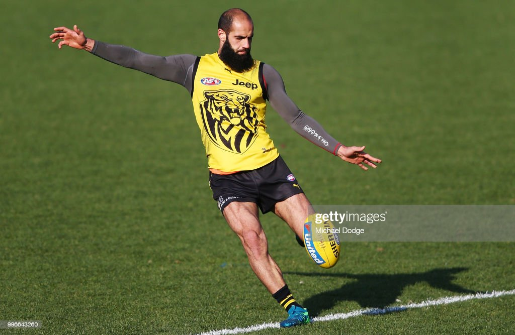 Bachar Houli of the Tigers, tipped by coach Damien Hardwick to return, kicks the ball during a Richmond Tigers AFL training session at Punt Road Oval on July 12, 2018 in Melbourne, Australia.