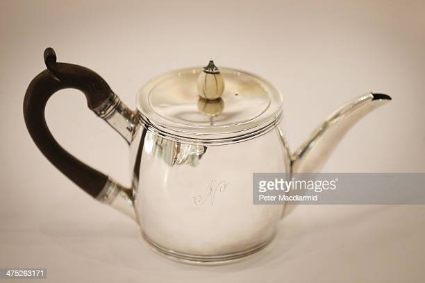 Bachelor teapot from 1799 engraved with an inital 'N' belonging Admiral Lord Nelson is displayed at Sotheby's on February 27 2014 in London England...