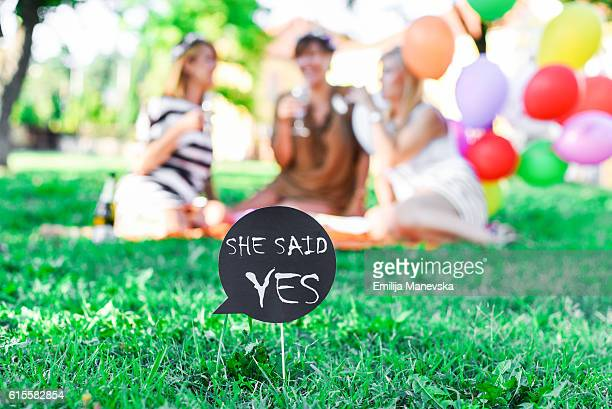 Bachelorette party. Word quotes of SHE SAID YES on card board