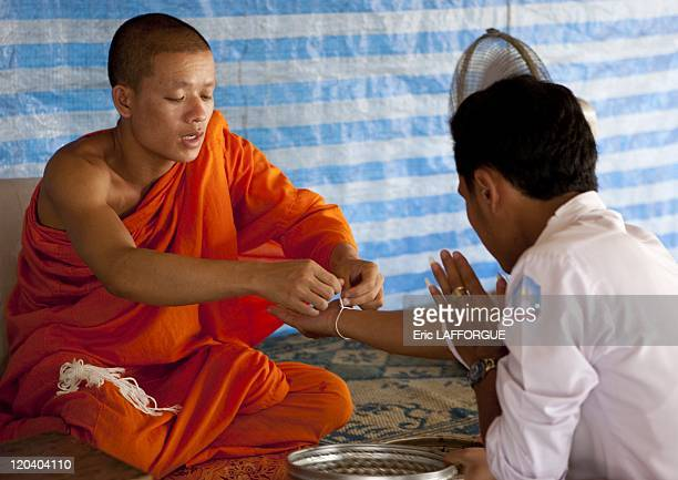 Baci ceremony in Vat Si Muang Vientiane Laos on April 21 2009 The Baci is a ceremony to celebrate a special event whether a wedding a homecoming a...
