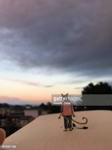 back against the evening sky - kouichi chiba stock photos and pictures