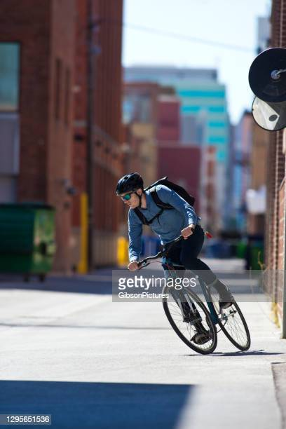 back alley bicycle commuter - taking a corner stock pictures, royalty-free photos & images