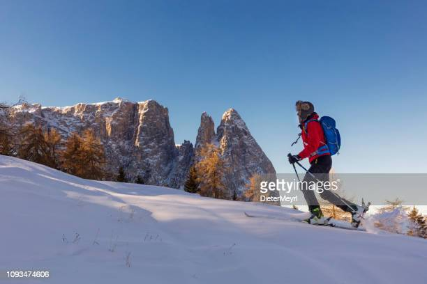 back country ski touring around sciliar mountains, dolomites, italy - dolomites stock pictures, royalty-free photos & images