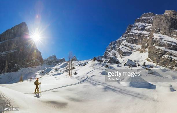 back country skier on white slopes at watzmann - alps - berchtesgaden stock photos and pictures