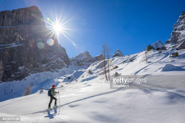 back country skier on white slopes at watzmann - alps - berchtesgadener land stock photos and pictures