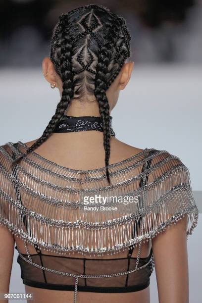 A back detail with hair geometric design pigtails and safty pin top during the Alexander Wang Resort Runway show June 2018 New York Fashion Week on...