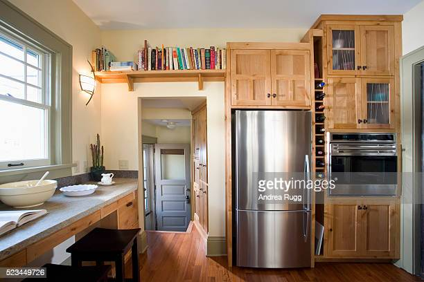 Back Door in Kitchen With Built-In Wood Cabinets