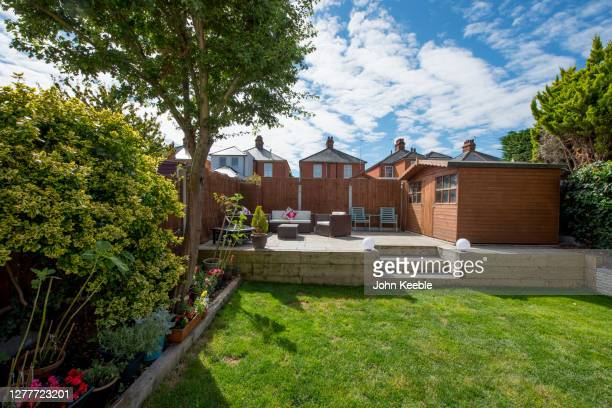 back garden exteriors - two seater sofa stock pictures, royalty-free photos & images