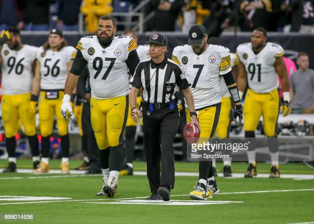 Back judge Greg Meyer walks with Pittsburgh Steelers defensive end Cameron Heyward and Pittsburgh Steelers quarterback Ben Roethlisberger for the...