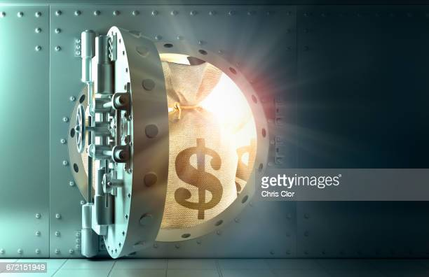 Back lit money bags with dollar symbol in vault