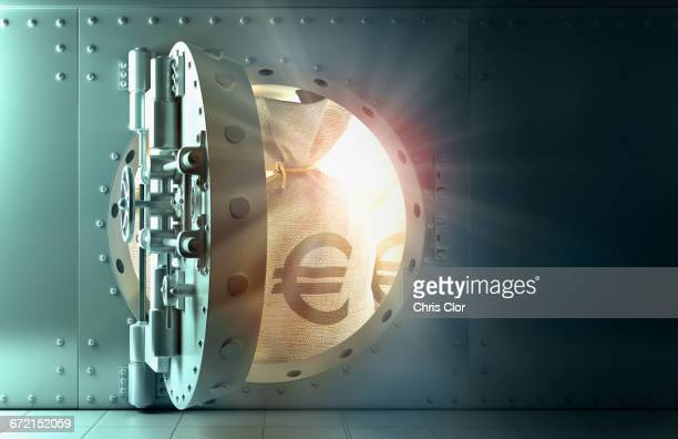 Back lit money bags with euro symbol in vault
