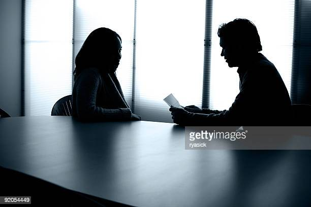Back Lit People Sitting at Conference Table Office Meeting Interview