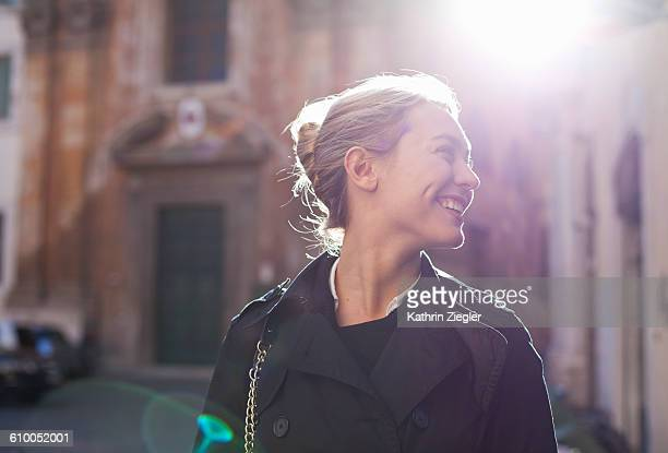 back lit portrait of happy young woman