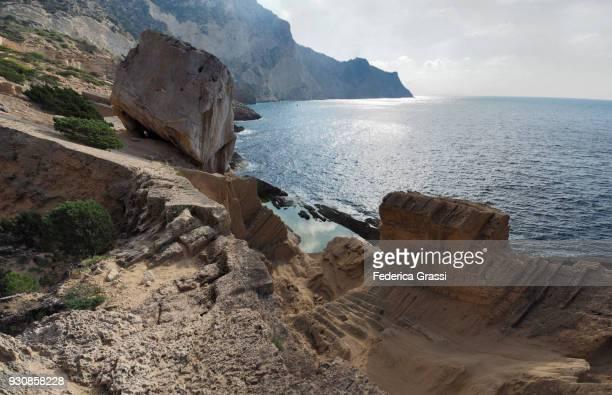 back lit view of the ancient phoenician stone quarry, sa pedrera, ibiza - unesco werelderfgoed stockfoto's en -beelden
