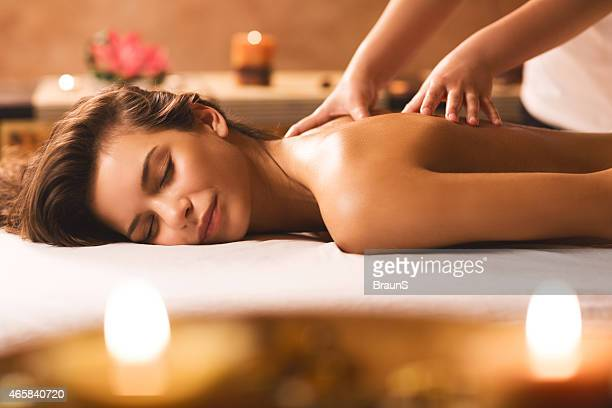 back massage at the spa. - massage therapist stock pictures, royalty-free photos & images