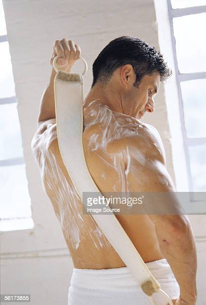 back massage - loofah stock photos and pictures
