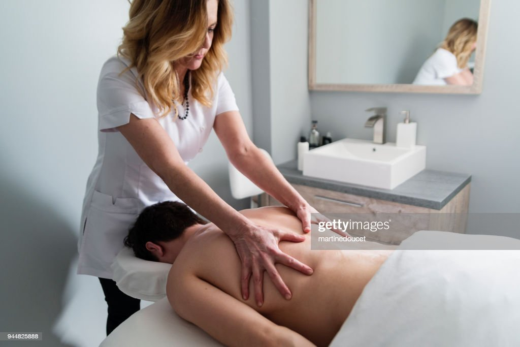 Back massage to young man in beauty spa. : Stock Photo