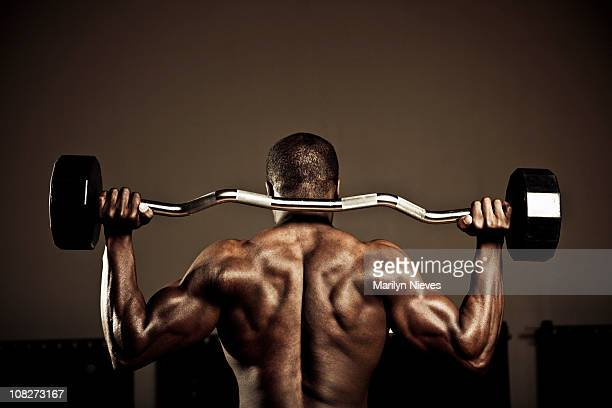 back muscles - black male bodybuilders stock photos and pictures