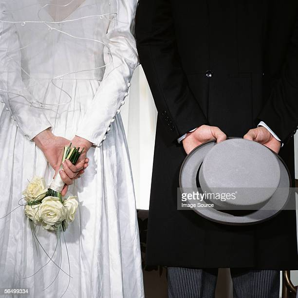back of a bride and groom - tail coat stock pictures, royalty-free photos & images
