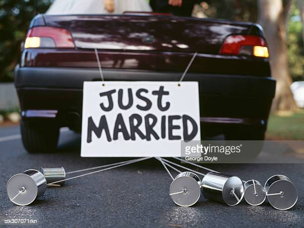 back of a car with a just married sign