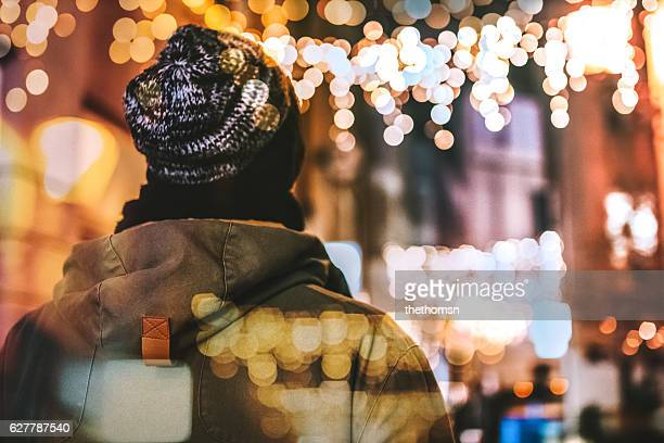 Back Of A Man During Christmas Season At Pedestrian Zone (Double Exposure)