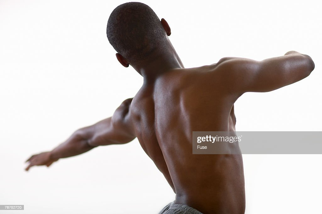 Back of Barechested Ballet Dancer : Stock Photo