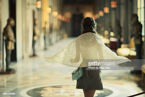 Back of beautiful woman in palace