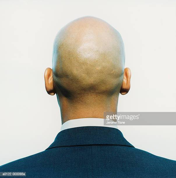 back of businessman's head - completamente calvo foto e immagini stock