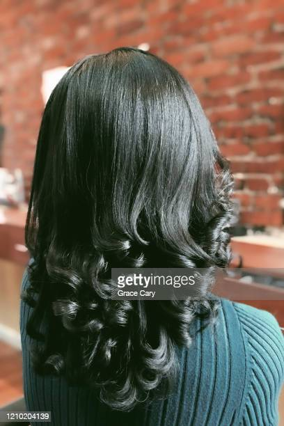 back of head of black woman with relaxed hair - straight hair stock pictures, royalty-free photos & images