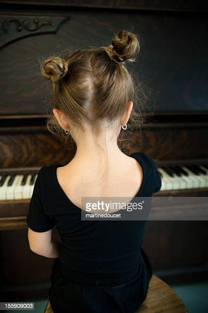 "back of little ballerina playing piano. - ""martine doucet"" or martinedoucet stock pictures, royalty-free photos & images"