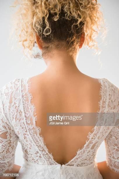 Back of Mixed Race woman wearing wedding dress