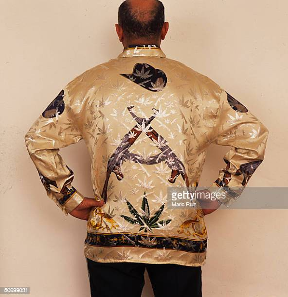 Back of narco chic shirt w marijuana leaf assault weapon print theme