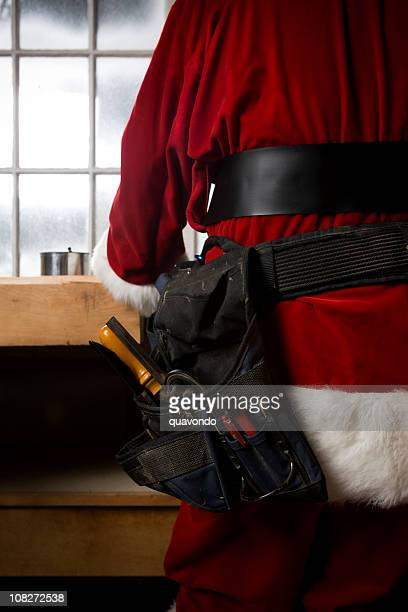 back of santa claus making toys in workshop, copy space - santas workshop stock photos and pictures