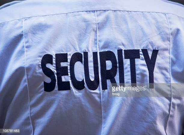 Back of security guard`s shirt