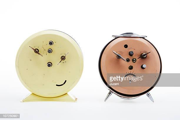 back of two vintage alarm clocks - pareidolia stock pictures, royalty-free photos & images