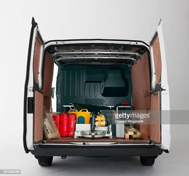 back of van with doors open and building materials - vehicle door stock pictures, royalty-free photos & images