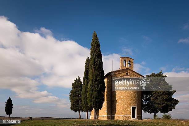 back of vitaleta chapel surrounded by cypress trees, val d'orcia - capella di vitaleta stock pictures, royalty-free photos & images