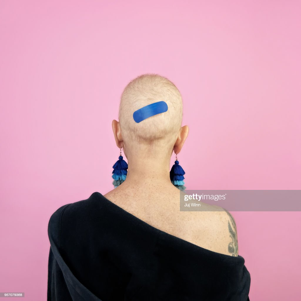 Back of woman's bald head with bandage : Stock Photo