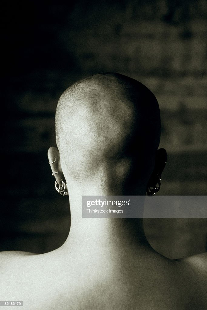 Back of woman's shaved head : Stock Photo
