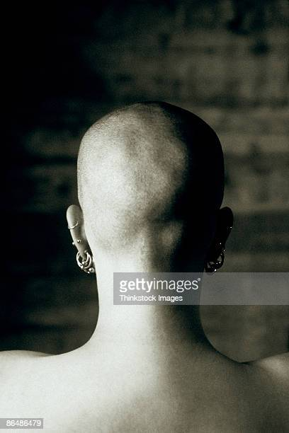 Back of woman's shaved head
