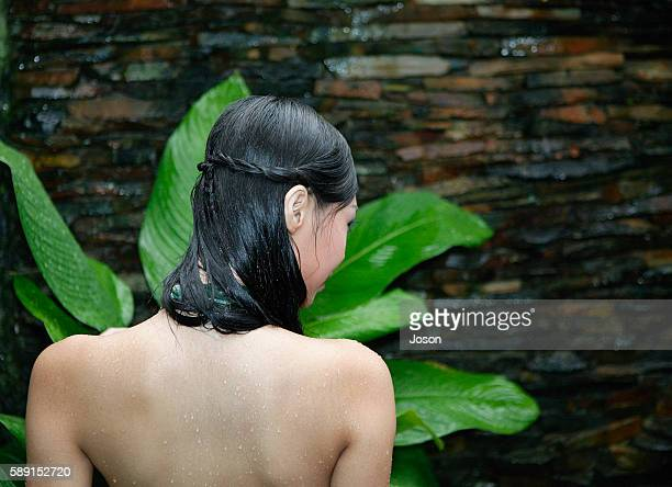 back of young woman and plant - backless stock pictures, royalty-free photos & images