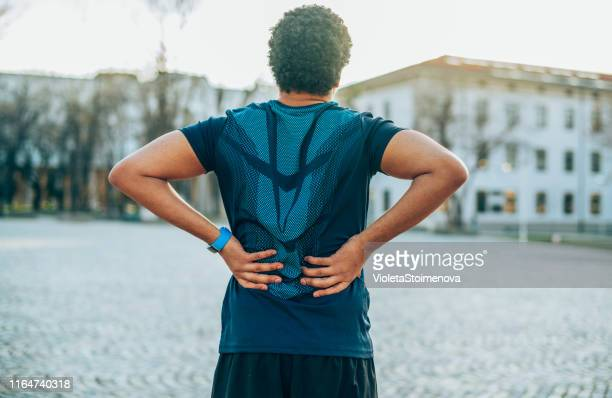 back pain. sport injury. - lower back stock pictures, royalty-free photos & images