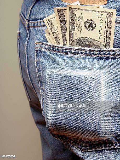 Back pocket bulging with money