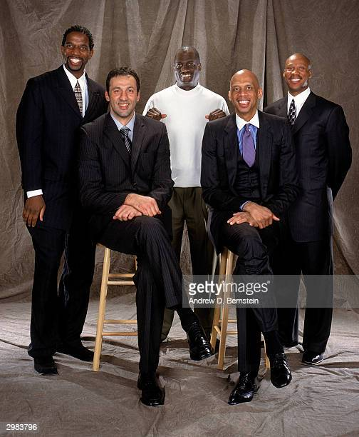 Back row AC Green Michael Cooper Byron Scott Front row Vlade Divac Kareem AbdulJabbar pose for a portrait during the American Express Tribute to...