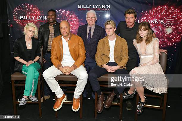 Back row Actors Chris Tucker Steve Martin Garrett Hedlun front row Kristen Stewart Vin Diesel Joe Alwyn and Makenzie Leigh attend the 'Billy Lynn's...