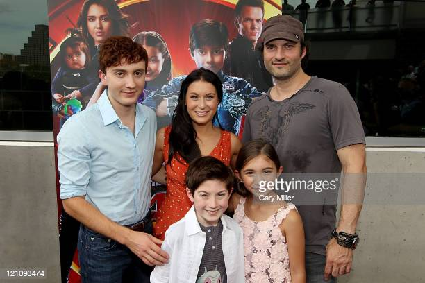 Back row Actors Daryl Sabara Alexa Vega and director Robert Rodriguez front row actors Mason Cook and Rowan Blanchard on the red carpet for the...