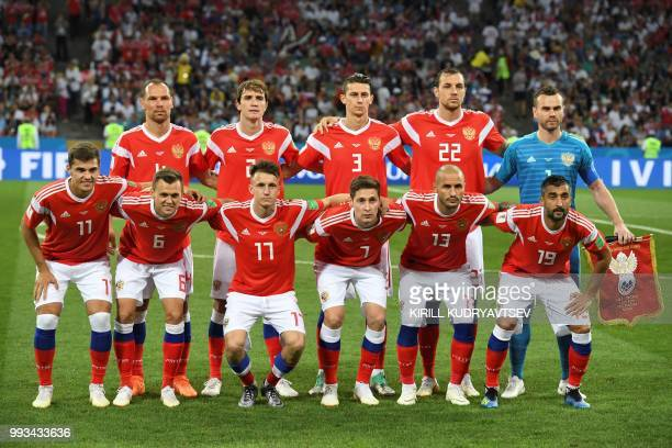 Russia's defender Sergey Ignashevich Russia's defender Mario Fernandes Russia's defender Ilja Kutepov Russia's forward Artem Dzyuba Russia's...