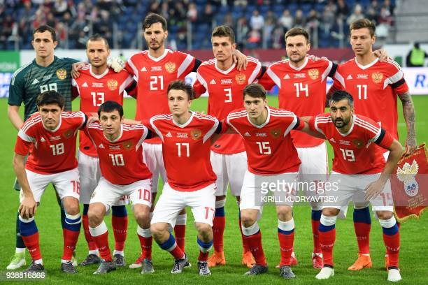 Russia's goalkeeper Andrey Lunyov Russia's defender Fyodor Kudryashov Russia's midfielder Aleksandr Erokhin Russia's defender Roman Neustaedter...