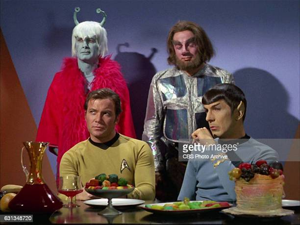 Back row from left Dick Geary as Andorian and Gary Downey as Tellarite front row from left William Shatner as Captain James T Kirk and Leonard Nimoy...